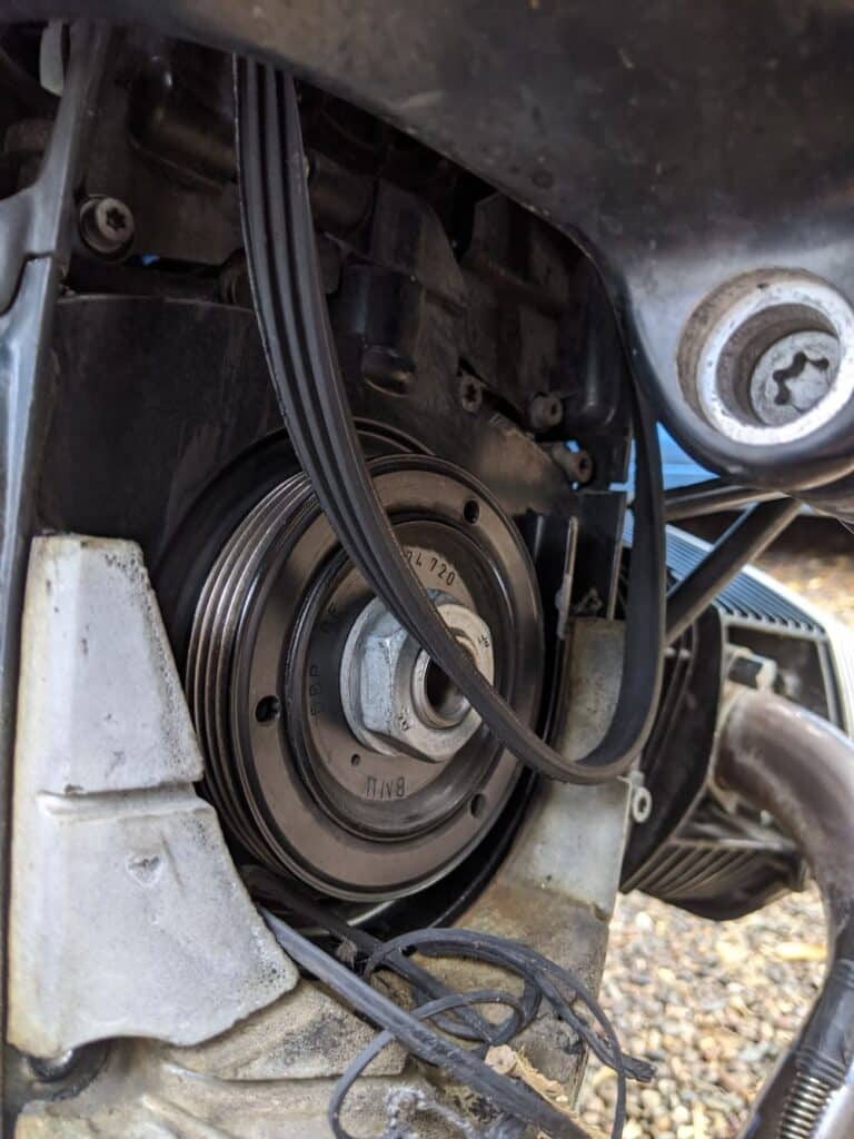 the broken bmw r1200 belt, with the big nut inside to turn