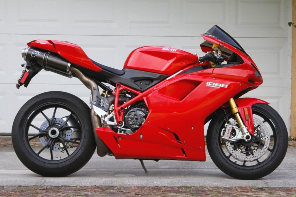 Red Ducati 1098, side profile, with under-seat exhaust and single-sided swing-arm