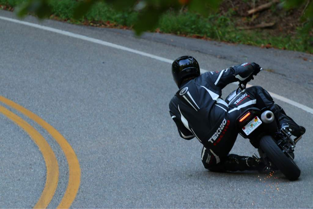 Getting a knee down on the Honda Grom in full leathers