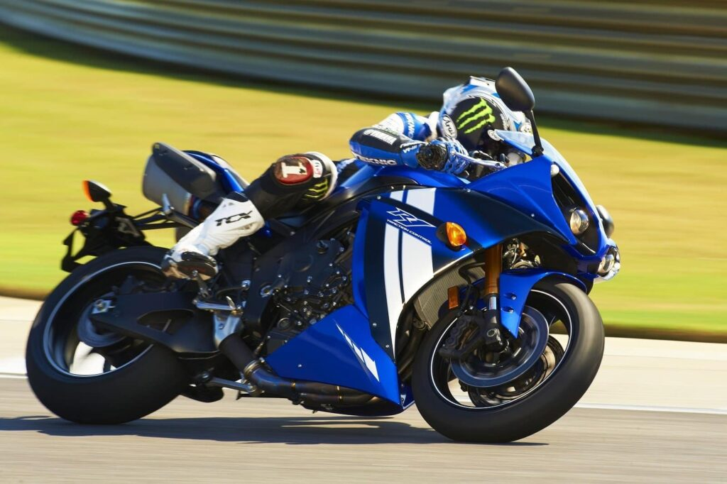 2012 blue yamaha r1 action shot leaned over on track