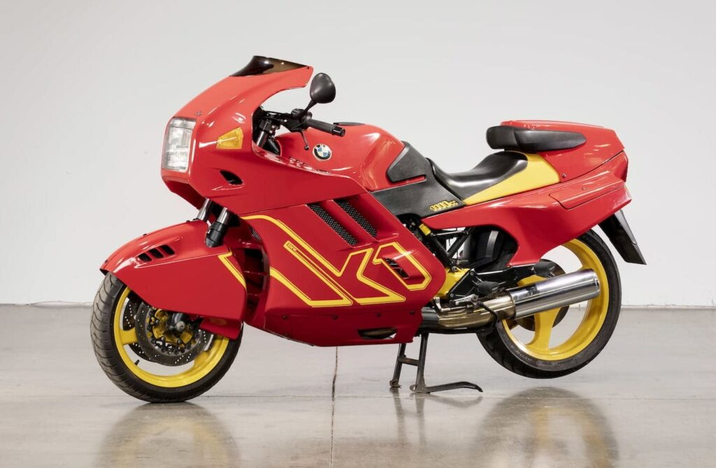 BMW K1 motorcycle with flying brick engine underneat the red and yellow bodywork