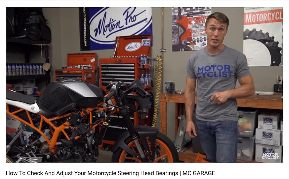 Checking motorcycle steering head bearings when inspecting a motorcycle.