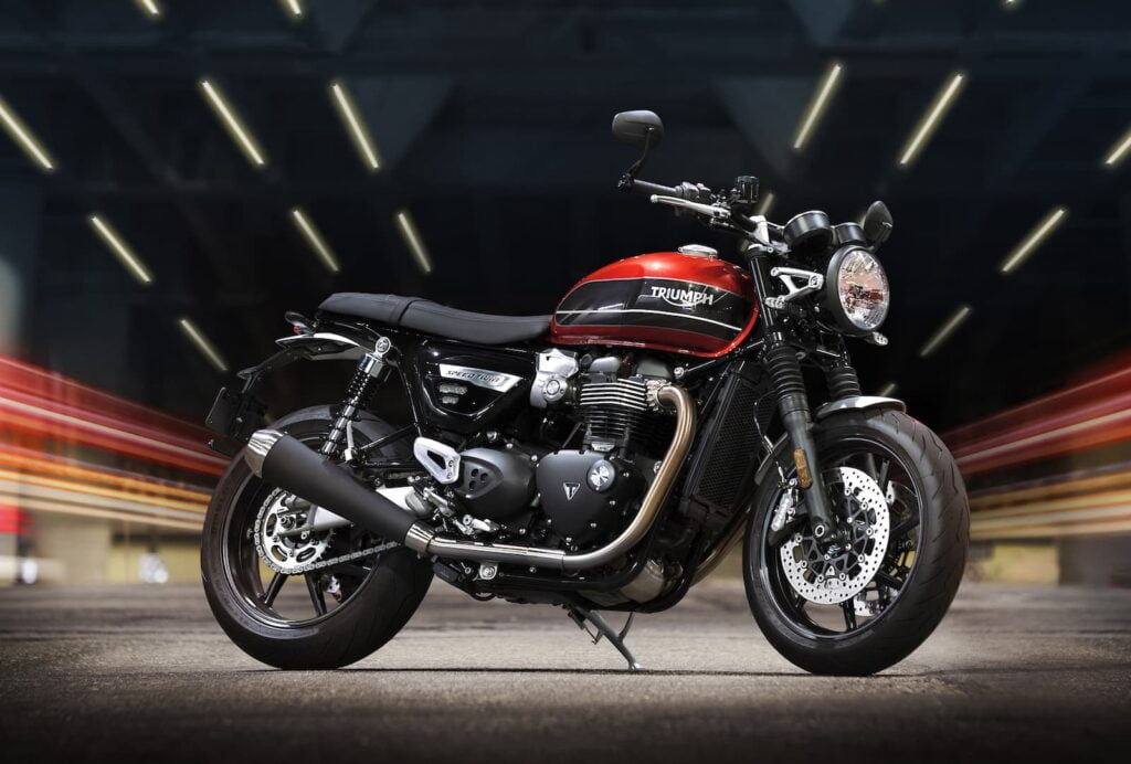 Triumph speed twin parked in tunnel night photo