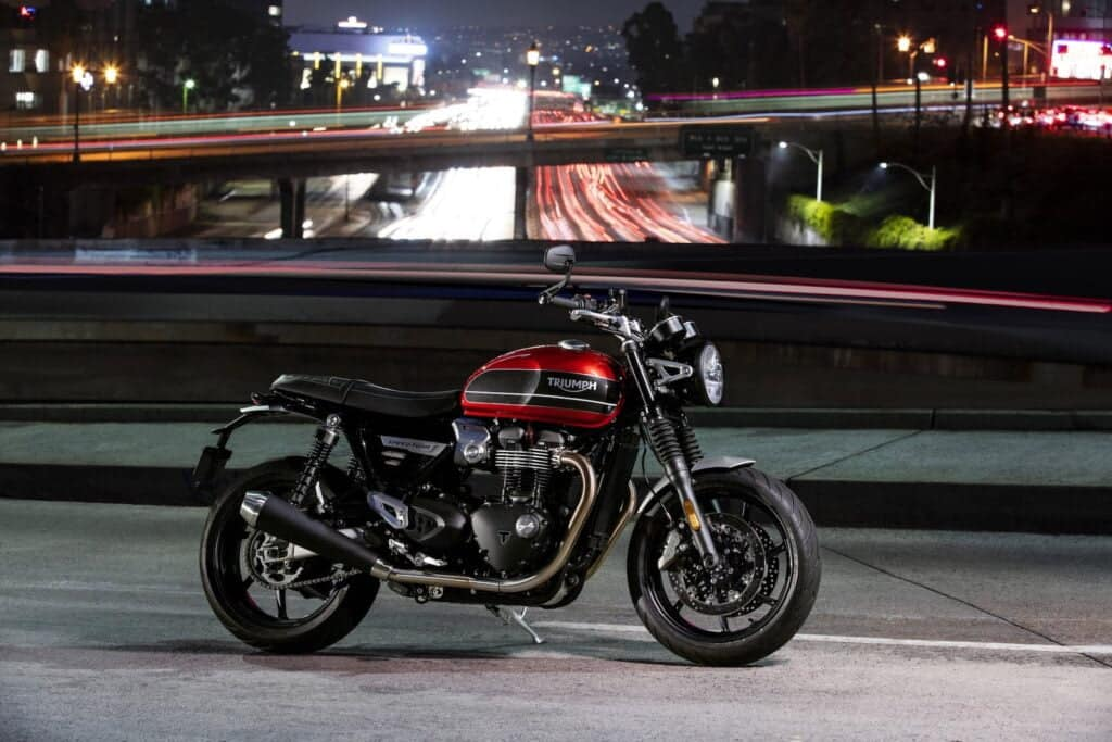 Night shot of Triumph Speed Twin, next to highway