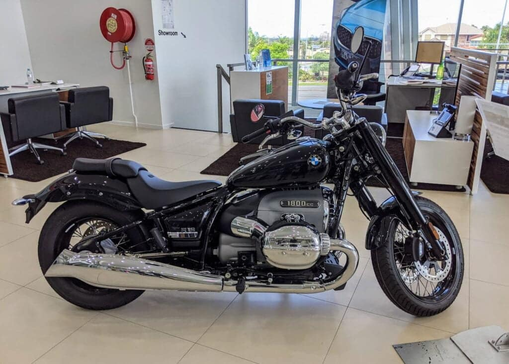 A BMW R 18 on the floor at a BMW motorrrad motorcycle dealership
