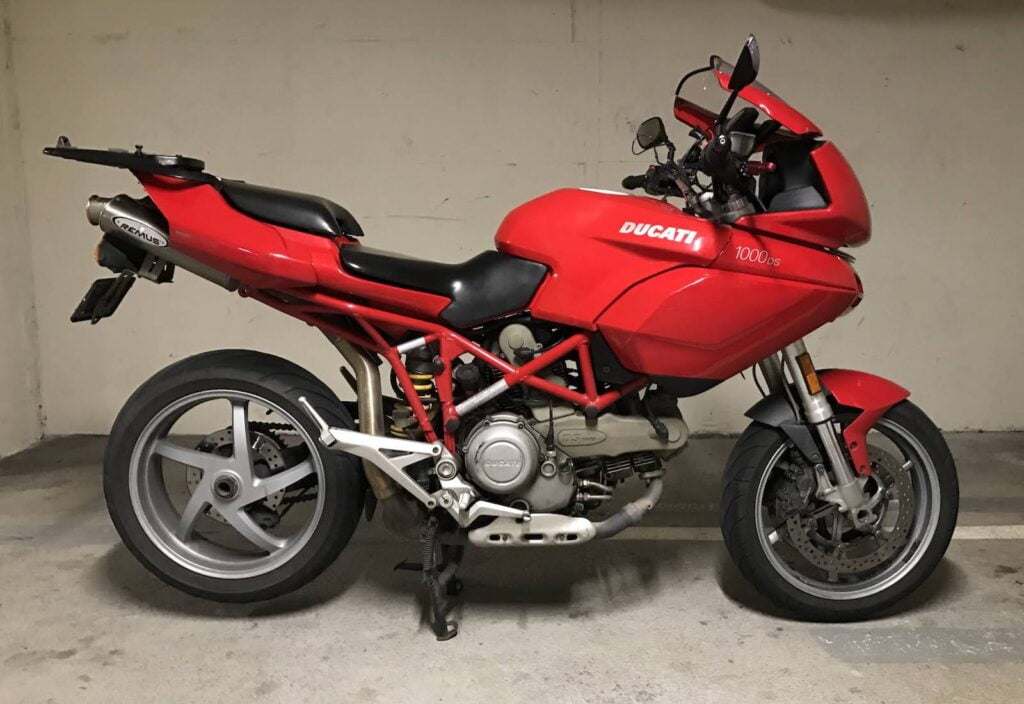 My multistrada 1000ds, red, parked in a garage